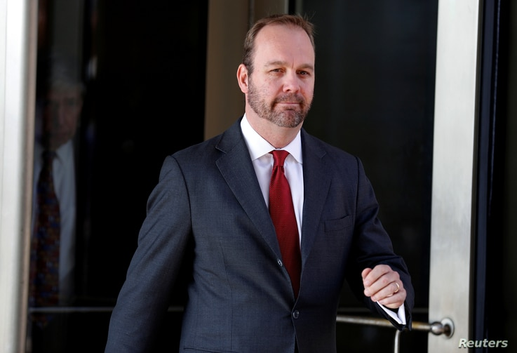 FILE - Rick Gates, former campaign aide to U.S. President Donald Trump, departs after a bond hearing at U.S. District Court in Washington.