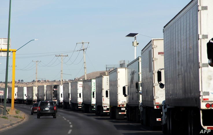 Cargo trucks lineup to cross to the United States near the US-Mexico border at the Cordova-Americas International Bridge in Ciudad Juarez, Chihuahua state, Mexico, on April 4, 2019.