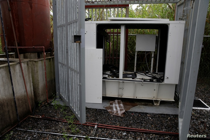 A vandalized backup generator is shown at a Movistar facility in Los Teques, Venezuela, Nov. 21, 2016.