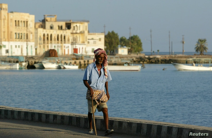 FILE - An Eritrean man walks alongside the Red Sea port of Massawa, 150km from the capital of Asmara.