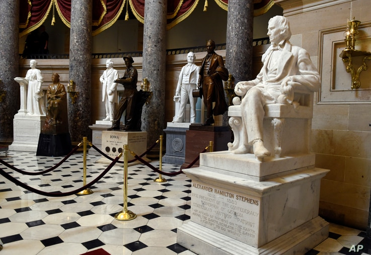 FILE - A statue of Alexander Hamilton Stephens is on display in Statuary Hall on Capitol Hill in Washington, June 24, 2015. The hall includes statues of Confederate Gen. Robert E. Lee, Confederate President Jefferson Davis and a number of other Confe...