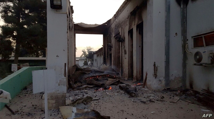 In this photograph released by Medecins Sans Frontieres (MSF) on Oct. 3, 2015, fires burn in part of the MSF hospital in the Afghan city of Kunduz after it was hit by an air strike.