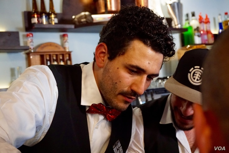 Andrea Oramai Sterpino is so committed to Celleno that he's opening businesses in the village. He pours drinks at his bar.
