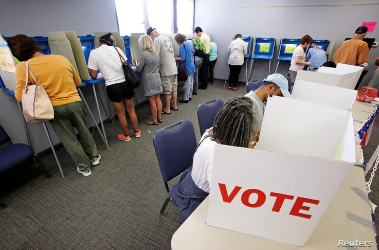 FILE - People cast their ballots in the 2016 general elections at a polling station during early voting in Carrboro, North Carolina, Oct. 20, 2016.