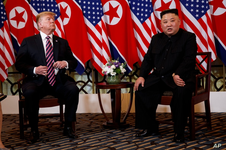 President Donald Trump listens as North Korean leader Kim Jong Un speaks during a meeting, Feb. 27, 2019, in Hanoi.
