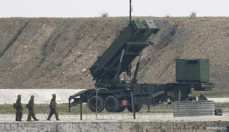 Japanese Self-Defence Force's soldiers are seen next to a Patriot missile system on the Japanese southern island of Ishigaki, Okinawa Feb. 7, 2016.