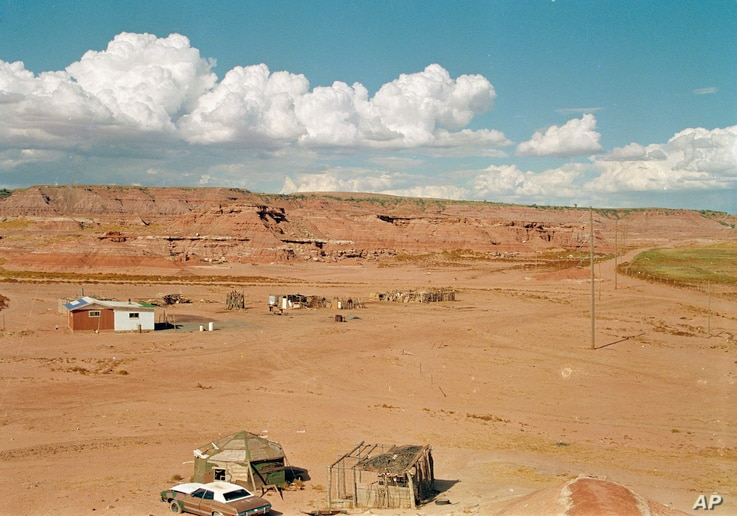 FILE - An isolated Navajo home located in a small canyon east of Tuba City, Ariz., Aug. 30, 1993.  Many Navajo don't have street addresses, a requirement for voting in Arizona.  (AP Photo/Jeff Robbins)