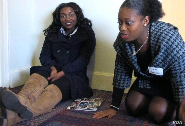 Jeniah Hunter, left, and Ebony Venson huddle with a small group to determine its campaign platform.