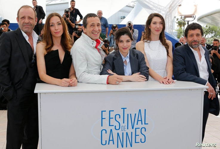 """(L-R) Cast members Christian Gregori, Jessica Erickson, Richard Chevallier, Heloise Godet, Zoe Bruneau and Kamel Abdelli pose during a photocall for the film """"Adieu au langage"""" (Goodbye to Language) in competition at the 67th Cannes Film Festival in ..."""