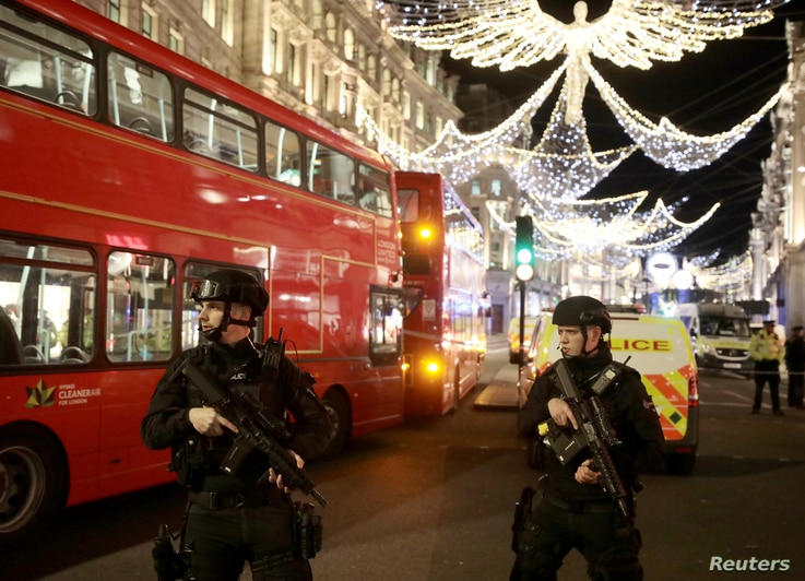 Armed police officers stand on Oxford Street, London, Britain, Nov. 24, 2017.