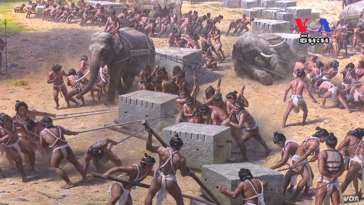 A mural of workers pulling stones to build temples at the North Korea's Angkor Panorama Museum in Siem Reap, Cambodia.