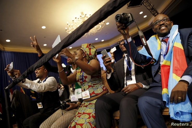 Attendees cheer as U.S. President Barack Obama (not pictured) arrives onstage at the Young African Leaders Initiative (YALI) Mandela Washington Fellowship Presidential Summit in Washington, August 3, 2015.