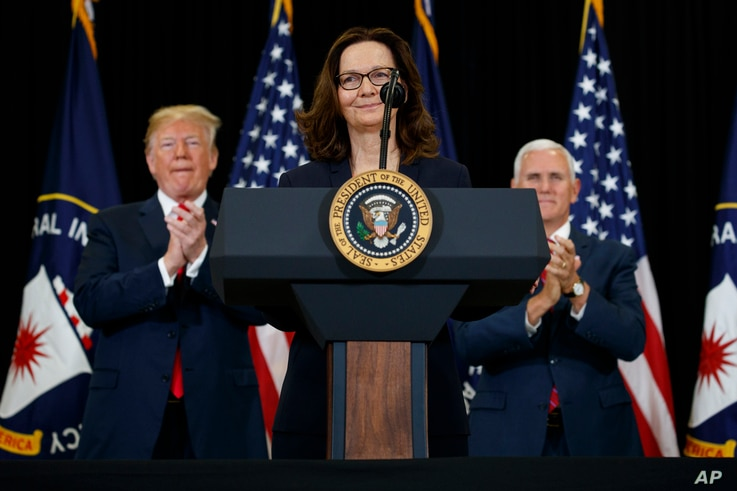 President Donald Trump and Vice President Mike Pence applaud incoming Central Intelligence Agency director Gina Haspel during a swearing-in ceremony at CIA Headquarters in Langley, Va., May 21, 2018.