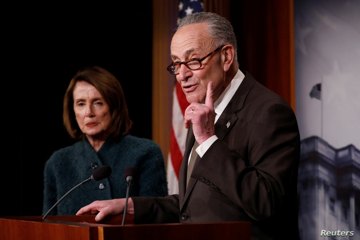 Senate Minority Leader Chuck Schumer, accompanied by House Minority Leader Nancy Pelosi, speaks at a news conference about the omnibus spending bill moving through Congress on Capitol Hill in Washington, March 22, 2018.