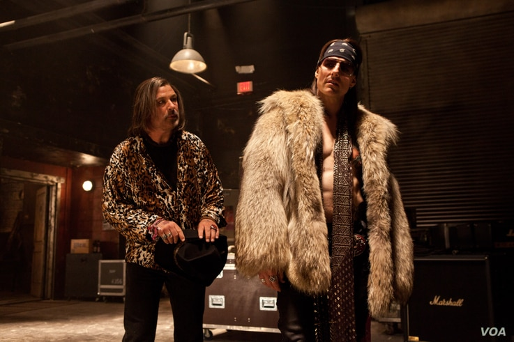 """(L-r) ALEC BALDWIN as Dennis Dupree and TOM CRUISE as Stacee Jaxx in New Line Cinema's rock musical """"ROCK OF AGES,"""" a Warner Bros. Pictures release. (Photo: Warner Bros. / David James)"""
