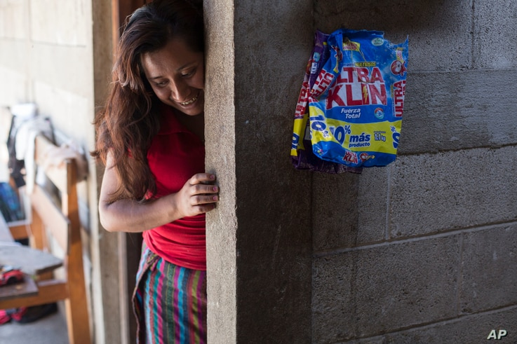 Paulina Gutierrez Alonzo, a 26-year-old Quiche indigenous woman, stands at her grandfather's house after giving an interview in Joyabaj, Guatemala, July 26, 2018. Gutierrez Alonzo was deported from United States in June and separated from her 7-year-...
