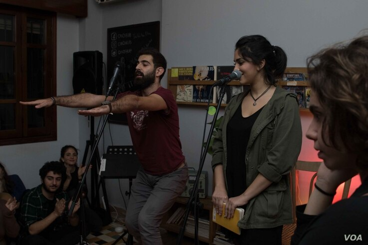 Majd Shidiac, left, at attending one of Poetry Pot events he founded.