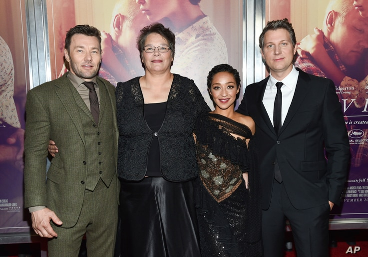 "Actor Joel Edgerton, left, Peggy Loving a daughter of Richard and Mildred Loving, actress Ruth Negga and director Jeff Nichols attend the premiere of ""Loving"" at the Landmark Sunshine Cinema, Oct. 26, 2016, in New York."
