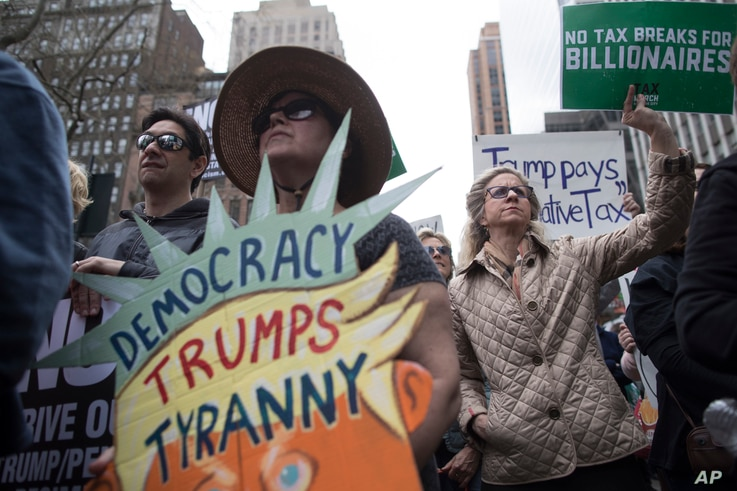 Demonstrators participate in a march and rally to demand President Donald Trump release his tax returns in New York, April 15, 2017.