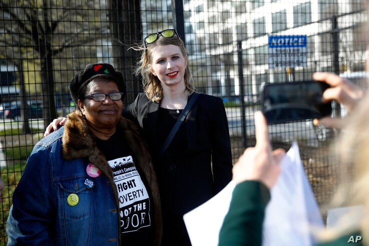Chelsea Manning, right, poses for a photograph with the Rev. Annie Chambers, a Green Party candidate for Maryland Lieutenant Governor, at an anti-fracking rally in Baltimore, Maryland, April 18, 2018.
