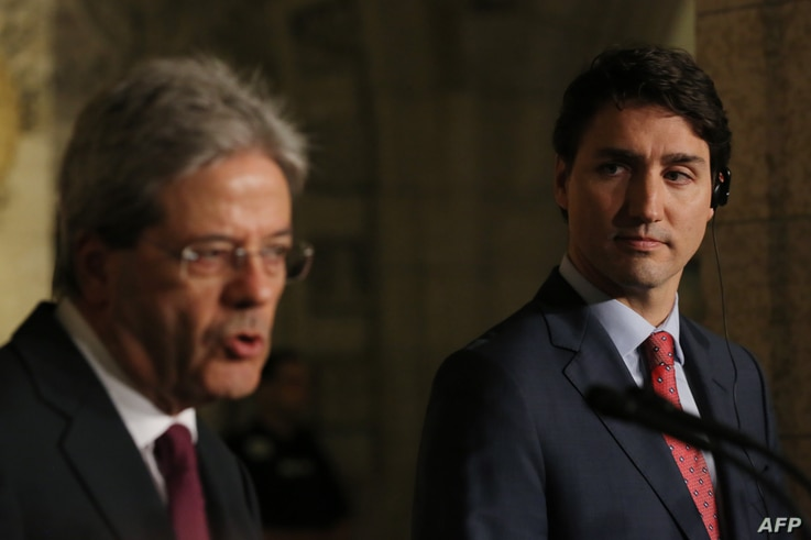 Canadian Prime Minister Justin Trudeau (R) and Prime Minister Paolo Gentiloni of Italy, hold a joint press conference in Ottawa, Ontario, April 21, 2017.