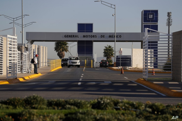 FILE - Cars exit the General Motors assembly plant in Villa de Reyes, outside San Luis Potosi, Mexico, Jan. 4, 2017. Mexico's growing share of the auto market is a sore spot for President Donald Trump, who has threatened to impose border taxes on M...
