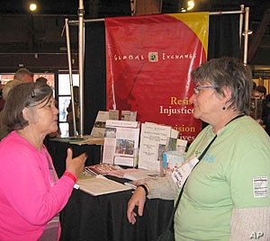Kirsten Moller talks with a visitor to this year's Green Festival