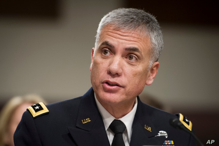 Army Lieutenant General Paul Nakasone appears before the Senate Armed Services Committee to discuss his qualifications as nominee to lead the National Security Agency and U.S. Cyber Command, during a hearing on Capitol Hill in Washington, March 1, 20...