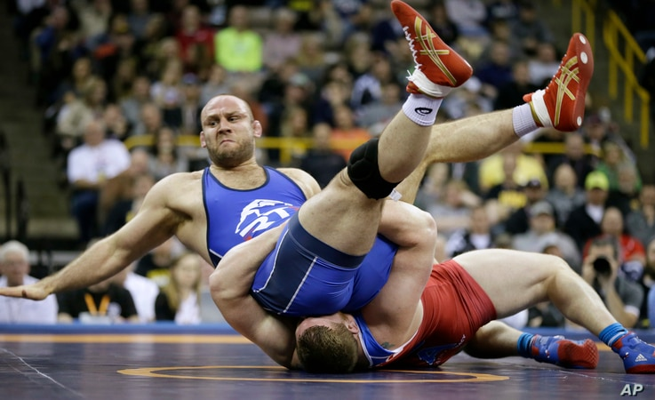 Tervel Dlagnev, top, is taken to the mat by Zach Rey during their 125-kilogram freestyle finals match at the U.S. Olympic Wrestling Team Trials, April 9, 2016, in Iowa City, Iowa.