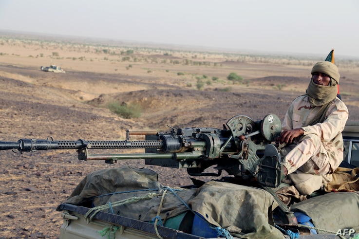 A Tuareg fighter of the Coordination of Movements of the Azawad (CMA) stand on a pick up truck with a machine gun near Kidal, northern Mali, Sept. 28, 2016,