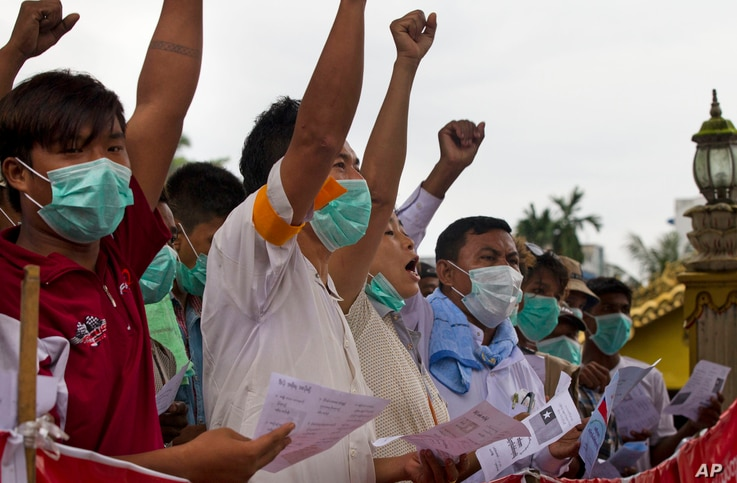 Buddhist nationalists protest, Aug. 3, 2017, in Yangon, Myanmar. The Buddhist monks and laymen claim the government has neglected the national interest and fails to hold the country's most vulnerable ethnic Muslim Rohingya minority in RakhinesState o...