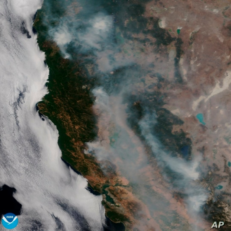 This satellite image released on Aug. 7, 2018 provided by NOAA shows the wildfires known as the Mendocino Complex, Calif. Northern California is grappling with the largest wildfire in California history, breaking a record set only months earlier.