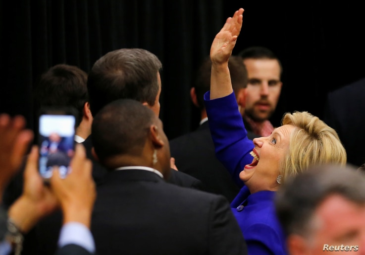 U.S. Democratic presidential candidate Hillary Clinton waves to supporters in the crowd during a campaign stop in Long Beach, California, June 6, 2016.