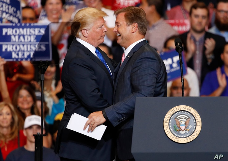President Donald Trump, left, embraces Sen. Dean Heller, R-Nev., during a campaign rally, Sept. 20, 2018, in Las Vegas.