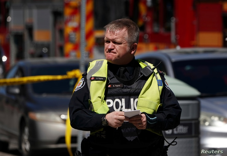 A pedestrian officer responds to an incident where a van struck multiple people at a major intersection in Toronto's northern suburbs in Toronto, Ontario, Canada, April 23, 2018.