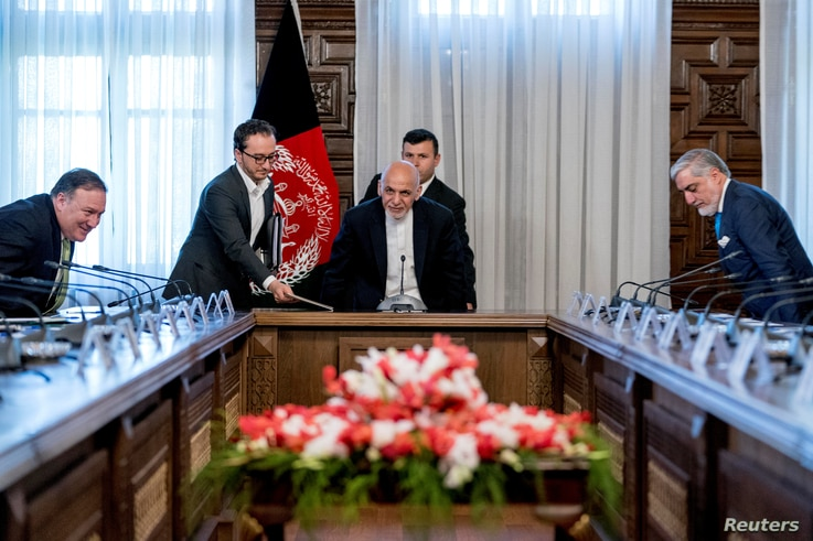 From left, U.S. Secretary of State Mike Pompeo, Afghan President Ashraf Ghani, and Afghan Chief Executive Abdullah Abdullah arrive for a meeting at the Gul Khanna in the Presidential Palace in Kabul, Afghanistan, July 9, 2018.