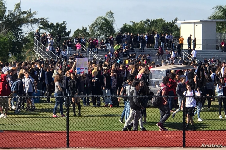 Students walkout at Marjory Stoneman Douglas High School during National School Walkout to protest gun violence in Parkland, Florida, March 14, 2018.