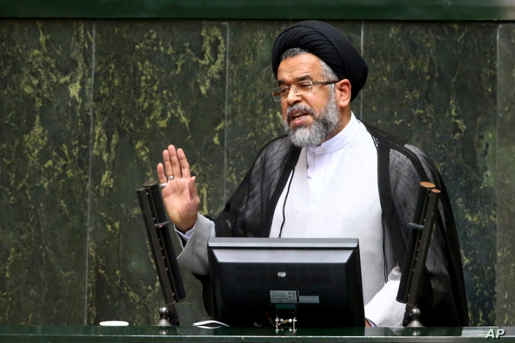"""FILE - Iranian Intelligence Minister Mahmoud Alavi answers lawmakers' questions in a session of parliament in Tehran, Iran, Oct. 25, 2016. Alavi said in August that agents """"spotted and thwarted more than 1,500 young people who intended to join"""" IS."""