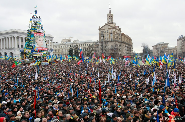 Supporters of EU integration are seen at a rally at Independence Square in central Kyiv, December 8, 2013.
