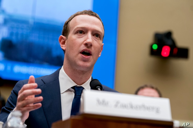 FILE - Facebook CEO Mark Zuckerberg testifies before a House Energy and Commerce hearing on Capitol Hill in Washington about the use of Facebook data to target American voters in the 2016 election and data privacy, April 11, 2018.