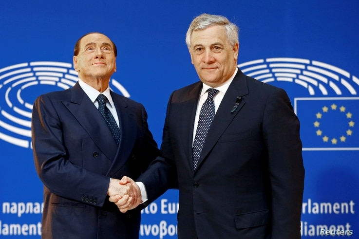 FILE - Italian former Prime Minister Silvio Berlusconi is welcomed by EU Parliament President Antonio Tajani, at the European Parliament in Strasbourg, France, July 1, 2017.