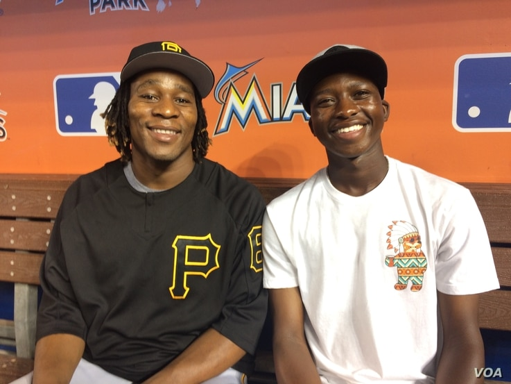 Gift Ngoepe with his brother, Victor, sit in the visitors dugout of the Miami Marlins ballpark in Florida. Victor Ngoepe, 19, also has a contract with the Pittsburgh Pirates and is playing on a minor league team in Florida.