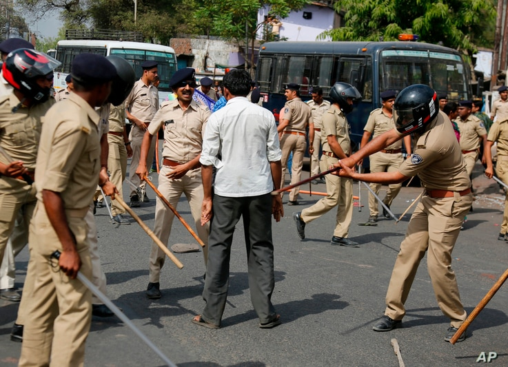 Indian policemen beat a lower caste Dalit protester during a nationwide strike in Ahmadabad, India, April 2, 2018.