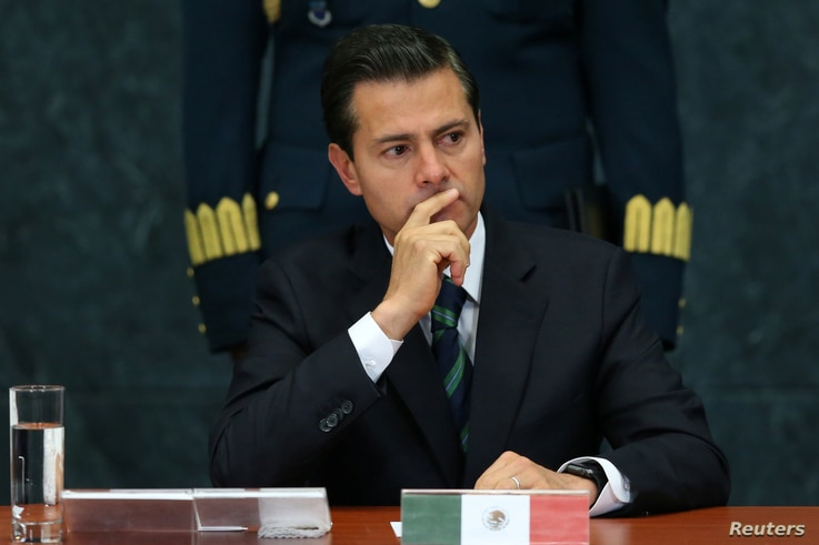Mexico's President Enrique Pena Nieto gestures during an event to recognize the contributions made by members of the Mexican foreign service, in Mexico City, April 28, 2017.