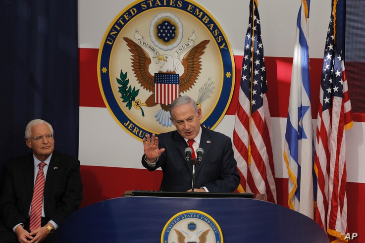 Israel's Prime Minister Benjamin Netanyahu delivers his speech as U.S. ambassador to Israel David Friedman listen, during the opening ceremony of the new US embassy in Jerusalem, May 14, 2018.