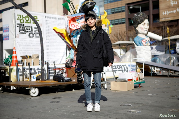 Jeung Un, 27, a freelance photographer, poses for a portrait at a site which protesters have occupied, in central Seoul, South Korea, Feb. 23, 2017.