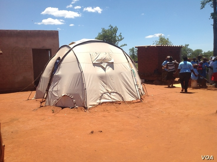 Some Chingwizi refugees have been living in this tent for the past two years, February 2016. (S. Mohfu/VOA)