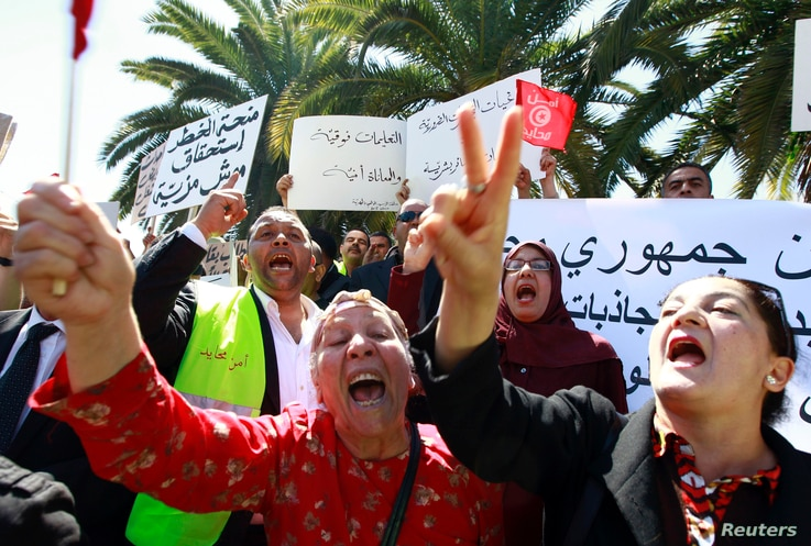 Tunisians shout slogans to demand tighter security within the country during a rally in front of the National Constituents Assembly in Bardo district in Tunis, May 10, 2013.