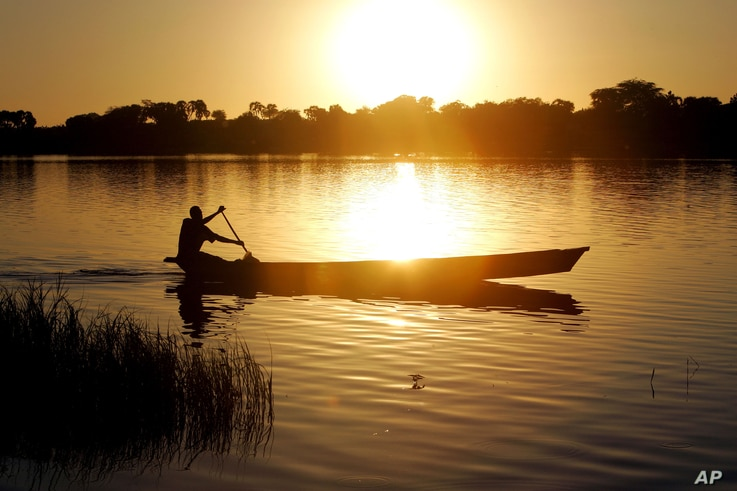 A  fisherman rows a canoe on Lake Chad, in Koudouboul, Chad, Nov. 25, 2006.