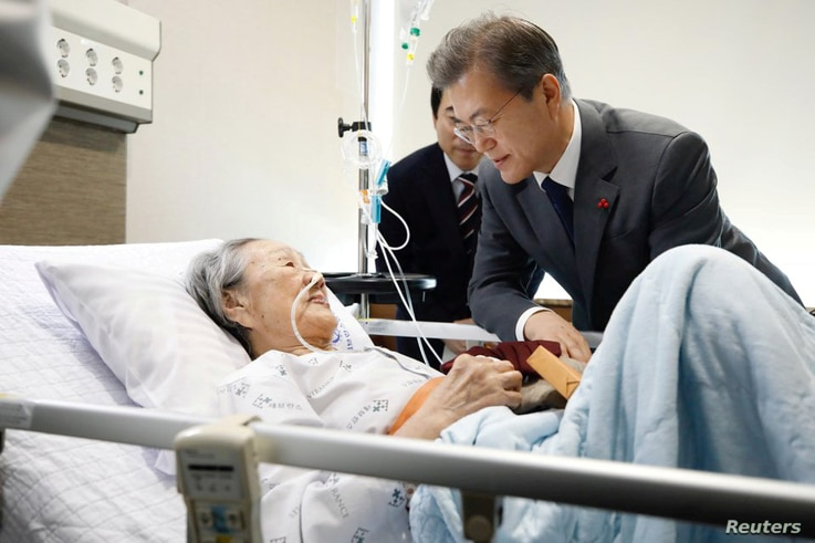 """South Korean President Moon Jae-in meets with South Korean Kim Bok-dong, who was abducted to serve as a """"comfort woman"""" for wartime Japanese soldiers, at a hospital in Seoul, South Korea."""